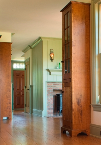 Painted pine tongue and groove wall paneling adds a sense of height to this room.
