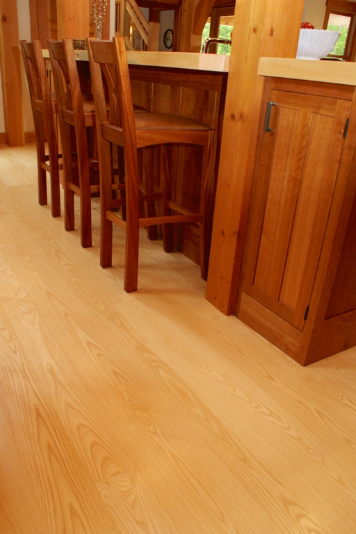 "Neutral colored ""blonde"" wood floors, in this case, select grade sapwood-only Ash wood, can provide a nice contrast with darker colored cabinetry and trim."