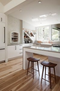 Warming up a white kitchen with a variegated wood floor.