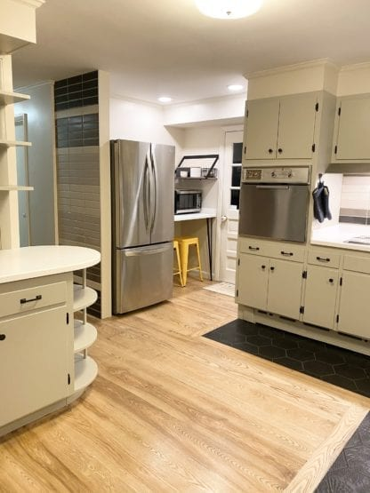kitchen with solid ash wide plank flooring