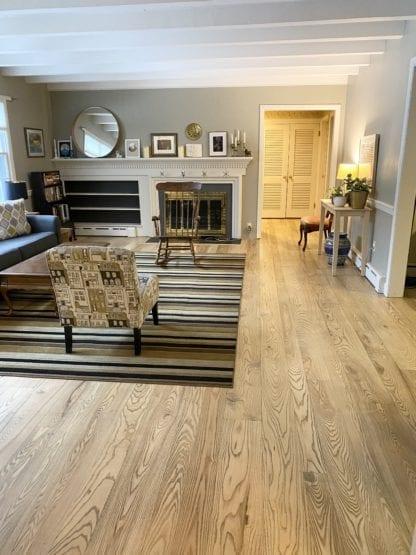 Ash wood flooring has a prominent grain.