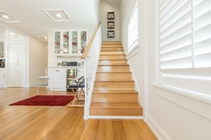 Quarter and rift sawn select grade white oak floor and matching stair treads in a Key West, Florida home.