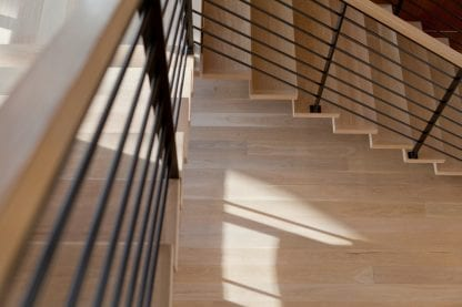 Select grade five inch white oak plainsawn floors and matching stairs.