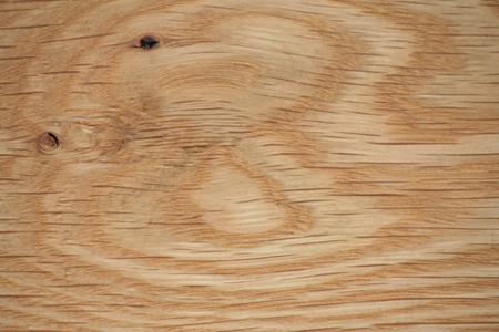 Close up view of the rays in the grain of a wide plank white oak floor.
