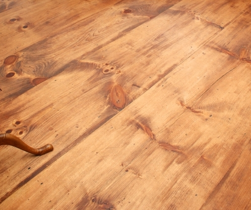 wide pine floor custom finished to look like old heart pine
