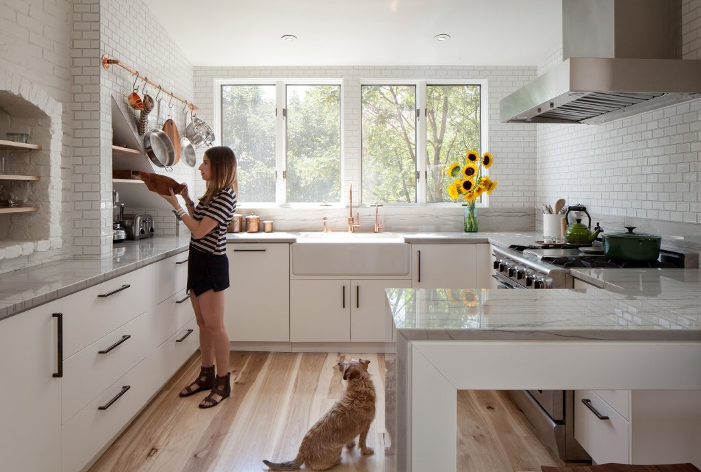Wood Flooring Warms Up A White Kitchen