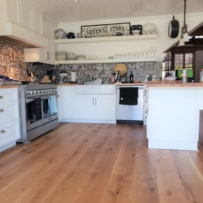kitchen with wide plank live sawn white oak flooring natural oil finish