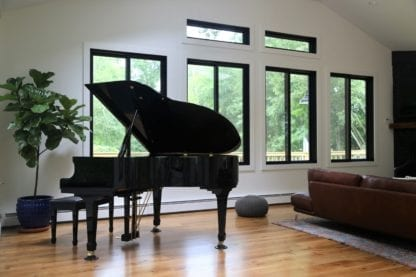 Piano room with live sawn white oak plank flooring