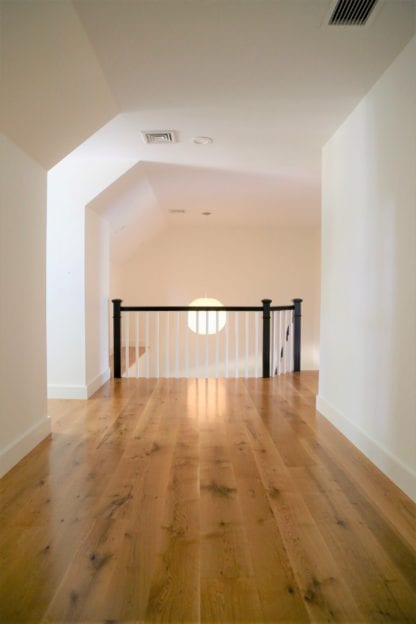 View of live sawn white oak flooring in a hallway showing the long plank lengths